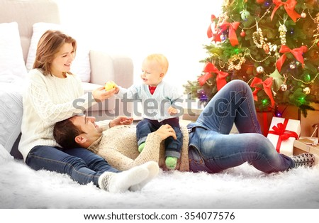 Christmas family portrait in home holiday living room - stock photo