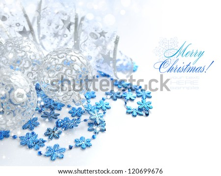 Christmas festive background with silver and blue baubles - stock photo