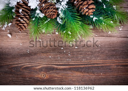 Christmas Fir Tree Border  on a wooden surface - stock photo