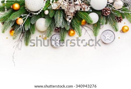 Christmas Fir Tree  Branches on a snow  surface. Christmas Holiday background. - stock photo