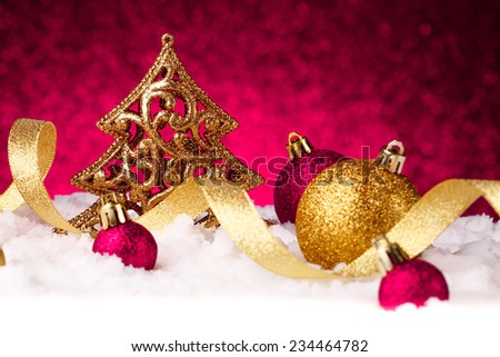 christmas fir tree decoration on red glitter background - stock photo