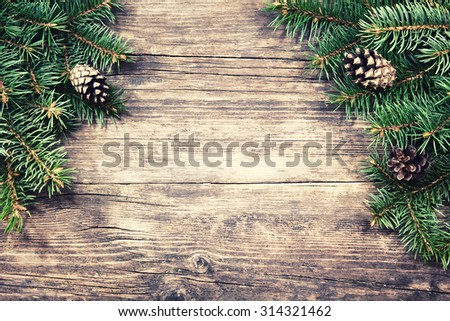Christmas fir tree on a wooden background, vintage style - stock photo