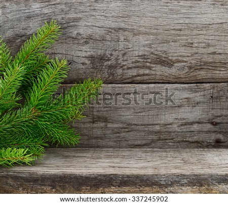 Christmas Fir Tree on old wooden background. - stock photo