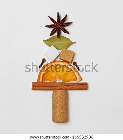 Christmas fir tree shape art creative decorative arrangement of mulled wine / punch / tea condiments - stock photo