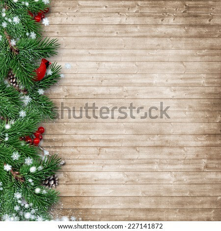 Christmas fir tree with a cardinal on a wooden background - stock photo