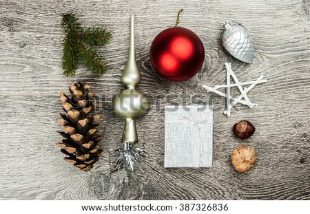 Christmas fir tree with cones and christmas tree decoration on a wooden background. Template for banner or bavkground, or image for a blog. - stock photo