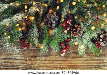 Christmas fir tree with decoration on wooden board