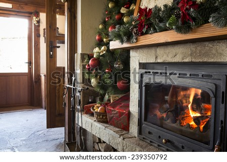 Christmas fireplace with christmas decorations in a restaurant - stock photo