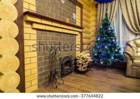 Christmas fireplace with firewood basket - stock photo
