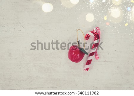 Christmas flat lay styled scene with decorations and copy space on white aged table, retro toned