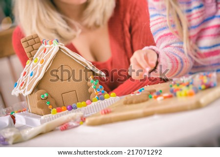 Christmas: Focus On Gingerbread House With Parent And Child