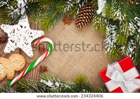 Christmas food, decor and gift box with snow fir tree background with copy space - stock photo