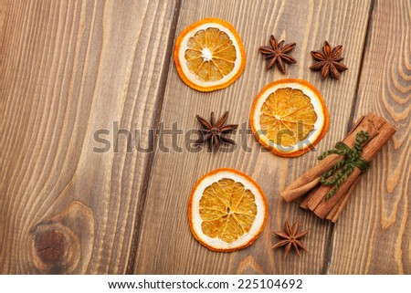 Christmas food decoration spices. View from above on wooden background with copy space - stock photo
