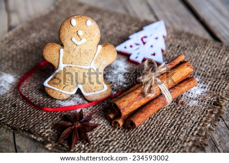 Christmas food. Gingerbread man cookies in Christmas setting.  dessert. cinnamon and star anise, beautiful spices - stock photo