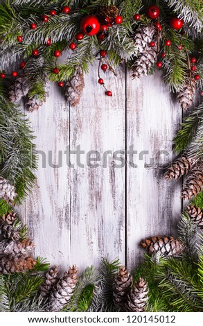 Christmas frame design with snow covered pinecones - stock photo