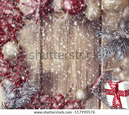 Christmas frame with Christmas balls, gift and shopping basket on a wooden background