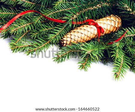 Christmas Frame with Fir Tree Branch and Christmas decoration isolated on white background. Evergreen Border with cone and red ribbon close up. - stock photo