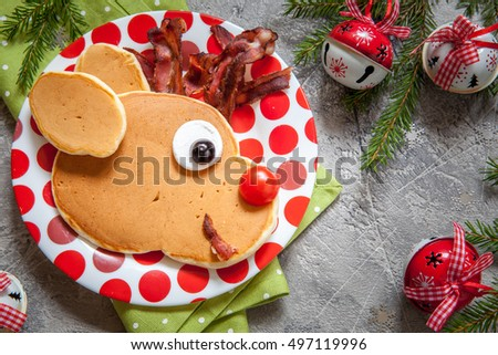 Christmas fun food for kids. Reindeer pancake for breakfast