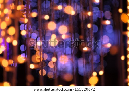 christmas garland blurred lights background with golden and violet colors