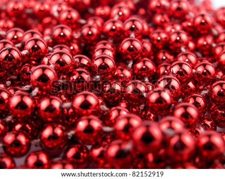 Christmas garland made from small red beads. - stock photo