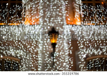 Christmas garland on a building, house, flashlights. soft focus background. - stock photo