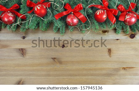 Christmas garland on rustic wood with copy space - stock photo