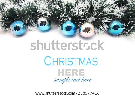 Christmas Garland with blue and silver bubbles isolated on white background - stock photo