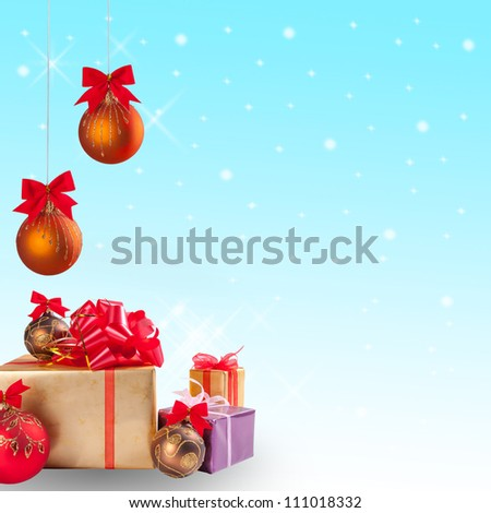 Christmas gift and balls with snow on festive background - stock photo
