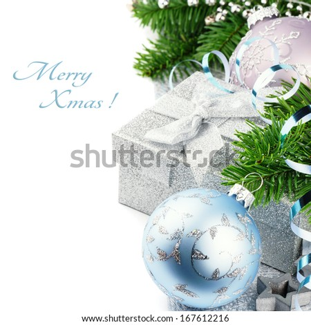 Christmas gift and festive ornaments isolated over white  - stock photo