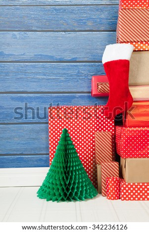 Christmas gift and stocking wrapped in red paper - stock photo