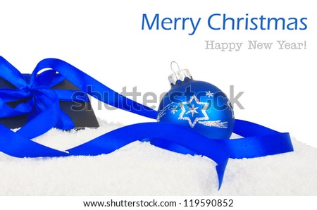 Christmas gift, black box with blue ribbon and balls on snow, New Year holiday photo & text