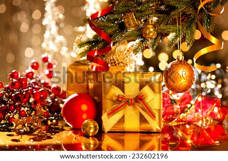 Christmas gift box and baubles. Christmas and New Year celebration. Decorated Christmas tree with various gifts Holiday Christmas scene. Christmas gifts under the Christmas tree - stock photo