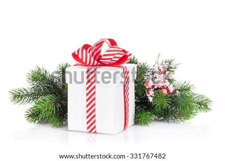 Christmas gift box and fir tree branch. Isolated on white background - stock photo