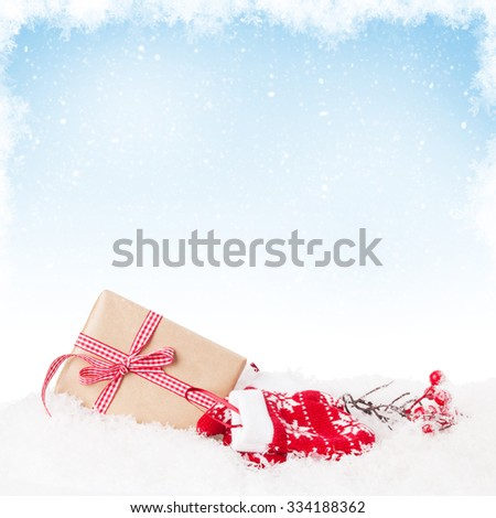 Christmas gift box in snow with background for copy space - stock photo