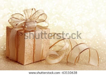 Christmas gift box on yellow background - stock photo