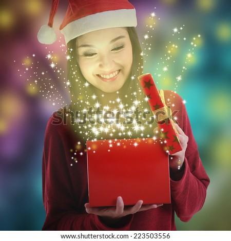 Christmas gift box opened from Asian Santa women  - stock photo