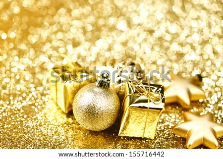 Christmas gift box with christmas balls on shiny background