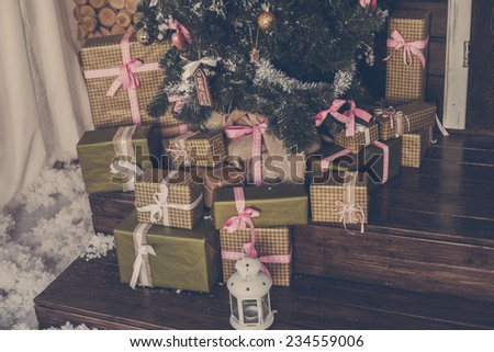 Christmas gift box with decoration - stock photo