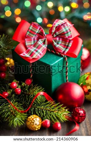 Christmas gift box with decorations - stock photo