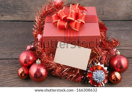Christmas gift box with decorations and color ball on wood
