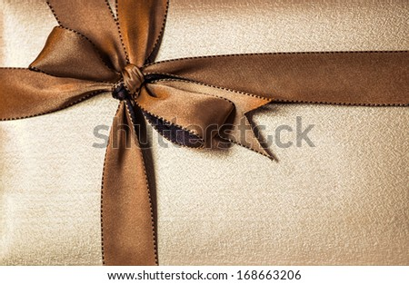 Christmas gift box with golden ribbon - stock photo