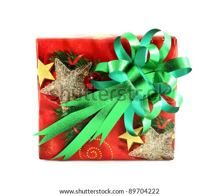 Christmas gift box with green bow isolated on white background