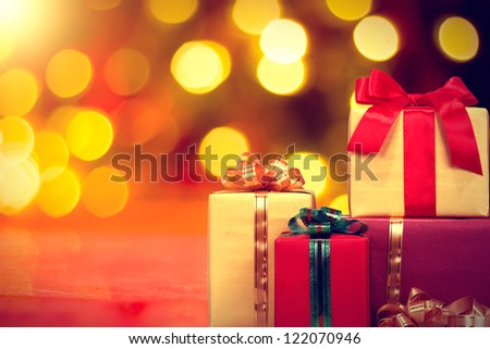 Christmas gift box with lights on background - stock photo