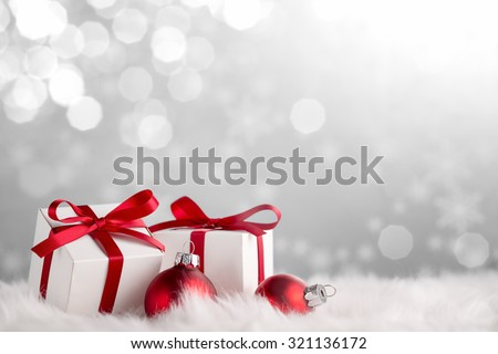 Christmas gift boxes and balls on snow - stock photo