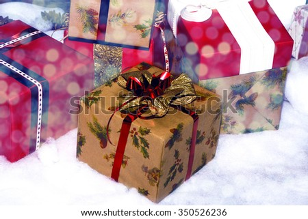Christmas gift boxes in shiny defocused lights - stock photo