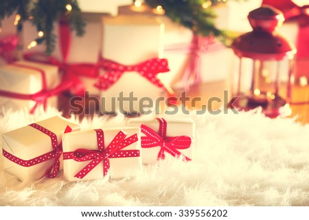 Christmas gift boxes on a white carpet at night - stock photo