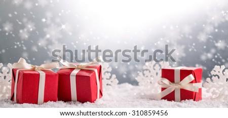 Christmas gift boxes on snow - stock photo