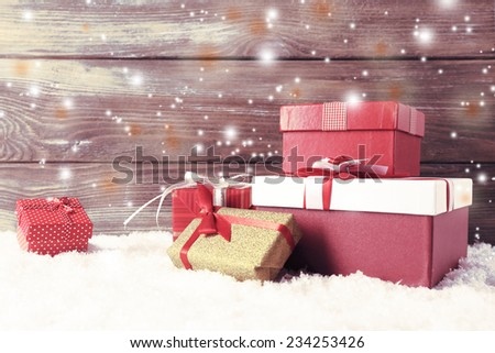 Christmas gift boxes on wooden background - stock photo