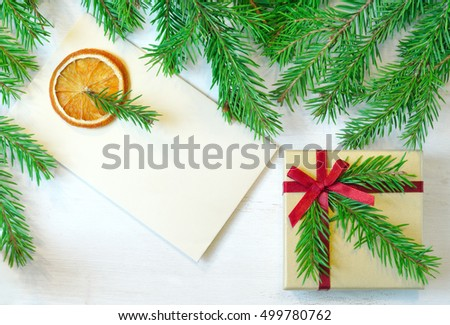 Christmas gift decorated with Christmas tree twig, envelope decorated with Christmas tree twig, christmas tree branches. Christmas mood photo. Christmas card. Christmas symbol. Preparing to Christmas.