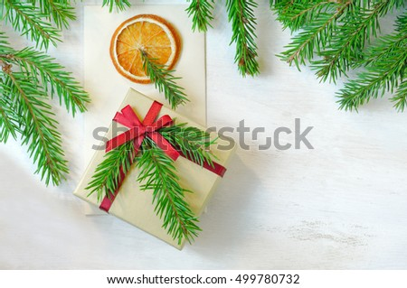 Christmas gift, envelope   christmas tree branches  with copy space. Overhead view. Christmas mood photo